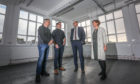 Angus Forbes, Convener of the Environment and Infrastructure Committee, Alan Farnington, Wasps Project Officer, David Littlejohn from Perth and Kinross Council and Audrey Carlin, Chief Executive of Wasps admire one of the studios which used to be a classroom.