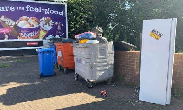 A fridge freezer is among the items dumped
