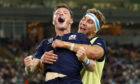 Pal Jamie Ritchie embraces George Horne after scoring against Russia.