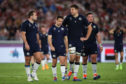 Greig Laidlaw (centre) is consoled by team mates at the end of Scotland's loss to Japan.