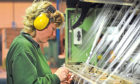 Textile worker Wendy Arthur at a  loom at Scott & Fyfe in Fife. Kim Cessford - 12.11.12 - pictured for business feature about textile firm Scott & Fyfe, Tayport in their Tayport works - Wendy Arthur ties off yarns. Also as file pic of textile industry.