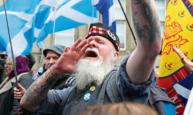 Scottish independence supporters march through Edinburgh during Saturday's All Under One Banner march.