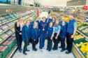 Olympic bronze medallist Sally Walton with area manager Carolin Bartmann, left, Robert Gray, right, and Aldi staff.