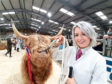 Sarah Noble with the female champion at Oban's Highland cattle show.