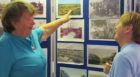 Margaret Copland President and Marianna Buultjens , Vice President, discussing displayed Monifieth pictures.