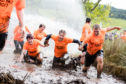 People tackling the Prime Four Beast Race  at Loch Ness - but it's coming to Fife.