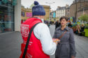 Claire Ferrier looks to purchase a Big Issue from vendor Brian
