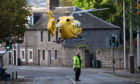 The air ambulance taking off from the scene in Perth