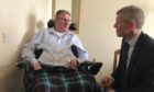 Douglas Dawson tells MSP Willie Rennie how a lack of care package has stranded him in a home for 18 months.
