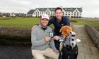 Carnoustie Golf Links chief executive Michael Wells presents Edwards with his engraved bag tag.