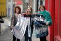 Shelter charity staff preview clothes ahead of fashion show.  Left to right: Phyl McGovern, Karen Kelbie & Anne Petrie.