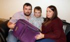 Dad Cameron, 38, Mum Donna Smith, 29, and son Caleb, 7, were 'scammed' out of a caravan holiday at Craig Tara.