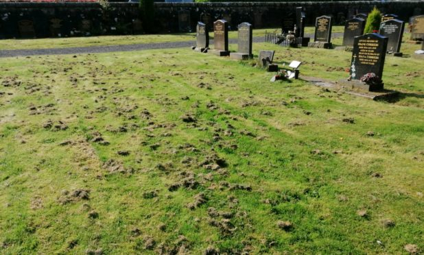 The cemetery at Kinross was left covered in grass cuttings.
