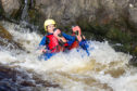 Gayle goes tubing on River Tummel.