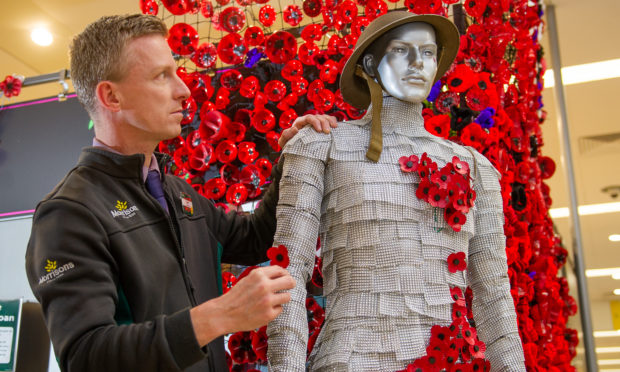 Keptie Kev has donned a WW1 issue helmet and stands pride of place in the centre of the Armistice Day display as Poppy Pete in Morrisons supermarket on Hume Street, Arbroath.