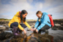 Gayle and Elizabeth Mills rockpooling near Arbroath.