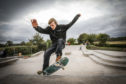 Adam Penman, Tayport Top Park Group chairman, tries out the new skatepark.
