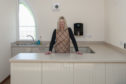Marion Brownlie Property Convenor, in the new kitchen.