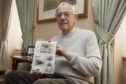 "Forfar historian Alex Whyte with one of his books on Forfar streets and places"","