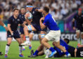 Scotland's Jamie Ritchie is tackled by Samoa's Jack Lam.