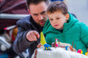 Michael White and son Adam view 2018's cakes.