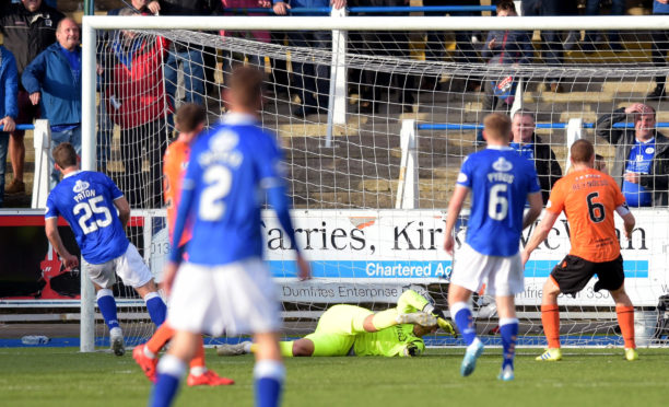 Michael Paton (25) makes it 4-0 to Queen of the South.