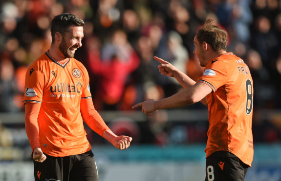 Nicky Clark (left) celebrates his freekick goal with teammate Peter Pawlett.