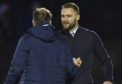 Dundee manager James McPake shakes hands with Paul McGowan at full time.