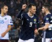 Lawrence Shankland celebrates his Scotland goal.