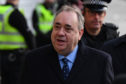 Alex Salmond arrives at the High Court in Edinburgh for a preliminary hearing on sexual assault charges.