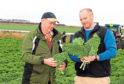 Andrew Faichney, right, with farmer Rob Stockwell at Barnsmuir Farm.