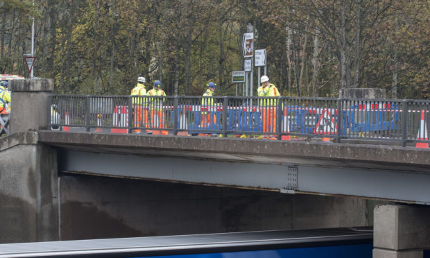 Engineers carried out an investigation at the bridge yesterday.