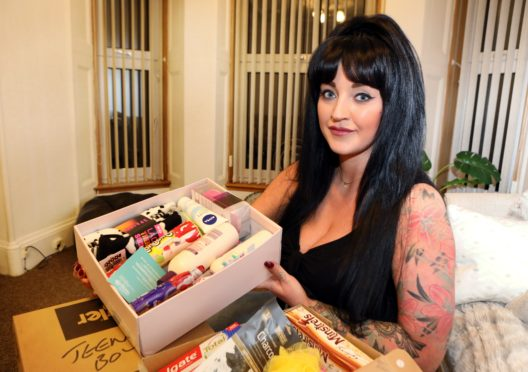 Amy Cruickshank with one of the Christmas boxes.