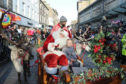 Lyla Steel aged 7 accompanied Santa in his sleigh last year.