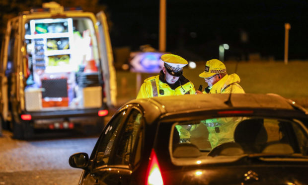 Police at the scene of the crash on Tuesday evening.