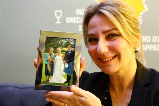 Laura Raimondi with a picture of her mother, at La Sicilyana cafe