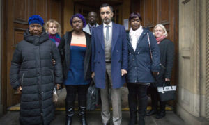 Solicitor Aamer Anwar (centre) arrives at the Crown Office in Edinburgh, with family members of the late Sheku Bayoh.