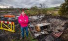David Paton at the destroyed huts.