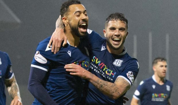 Kane Hemmings, left, after opening the scoring for Dundee.