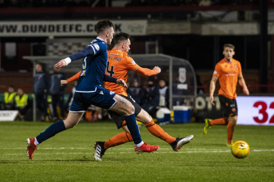 Lawrence Shankland makes it 2-0 to United.