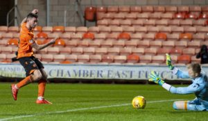 Sam Stanton slots home goal number three.