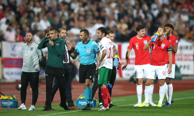 Match referee Ivan Bebek (centre) speaks to England manager Gareth Southgate with regards to racist chanting from fans during the UEFA Euro 2020 Qualifying match at the Vasil Levski National Stadium, Sofia, Bulgaria.