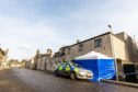 A tent has been erected by police at the rear of Drummonds Hotel as their investigation continues.