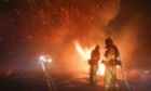 Firefighters battle a wildfire in Riverside, California.
