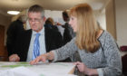Public presentation on Planning Application Notice for major housing development at Westfield Loan, Forfar. Picture shows; l to r - member of the public, Euan Cameron discusses the plans with Jacquie Forbes (Consulting Architect for the project), Lesser Reid Hall, Forfar, Wednesday 02nd May 2018