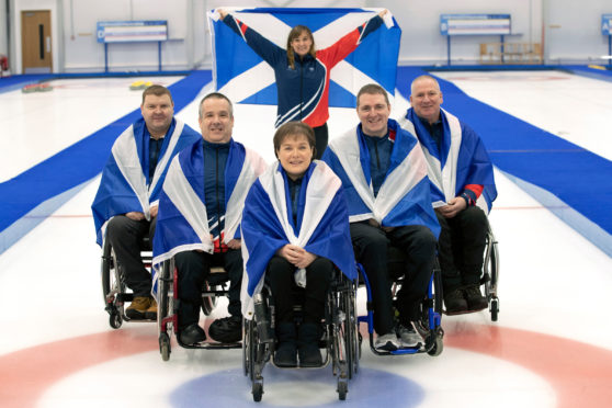 Silver-winning Scotland Wheelchair Curling Team. L-R: David Melrose, Robert McPherson, Aileen Neilson, Hugh Nibloe, Gary Logan. Back: Sheila Swan.  Picture: Graeme Hart.