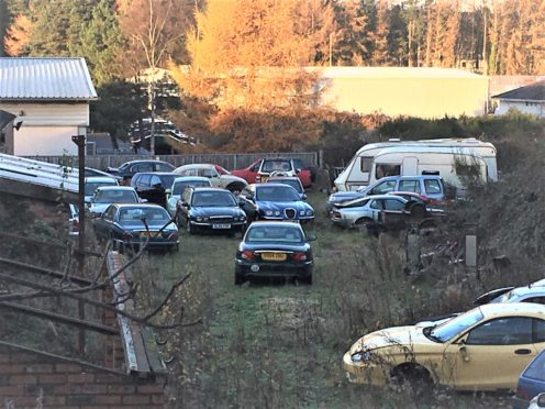 Cars parked behind the lock ups