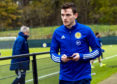 Andy Robertson on the sidelines during Scotland's training session.