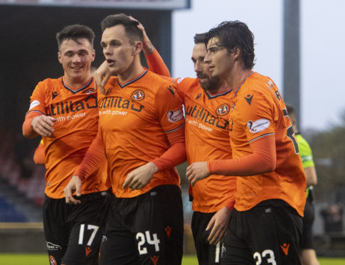 The United players celebrate the third goal.