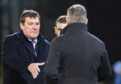Tommy Wright shakes hands with Craig Levein.